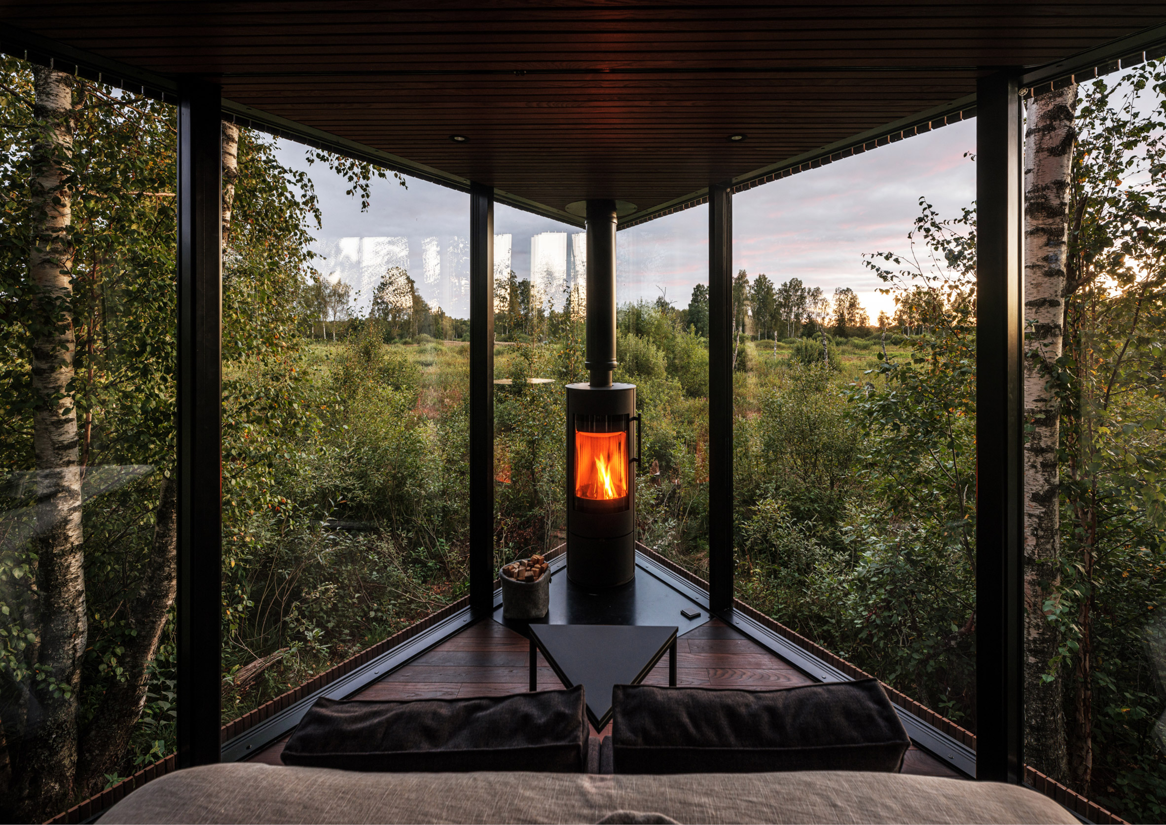 The glass-walled interior of a wooden cabin
