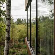 The glass walls of a cabin
