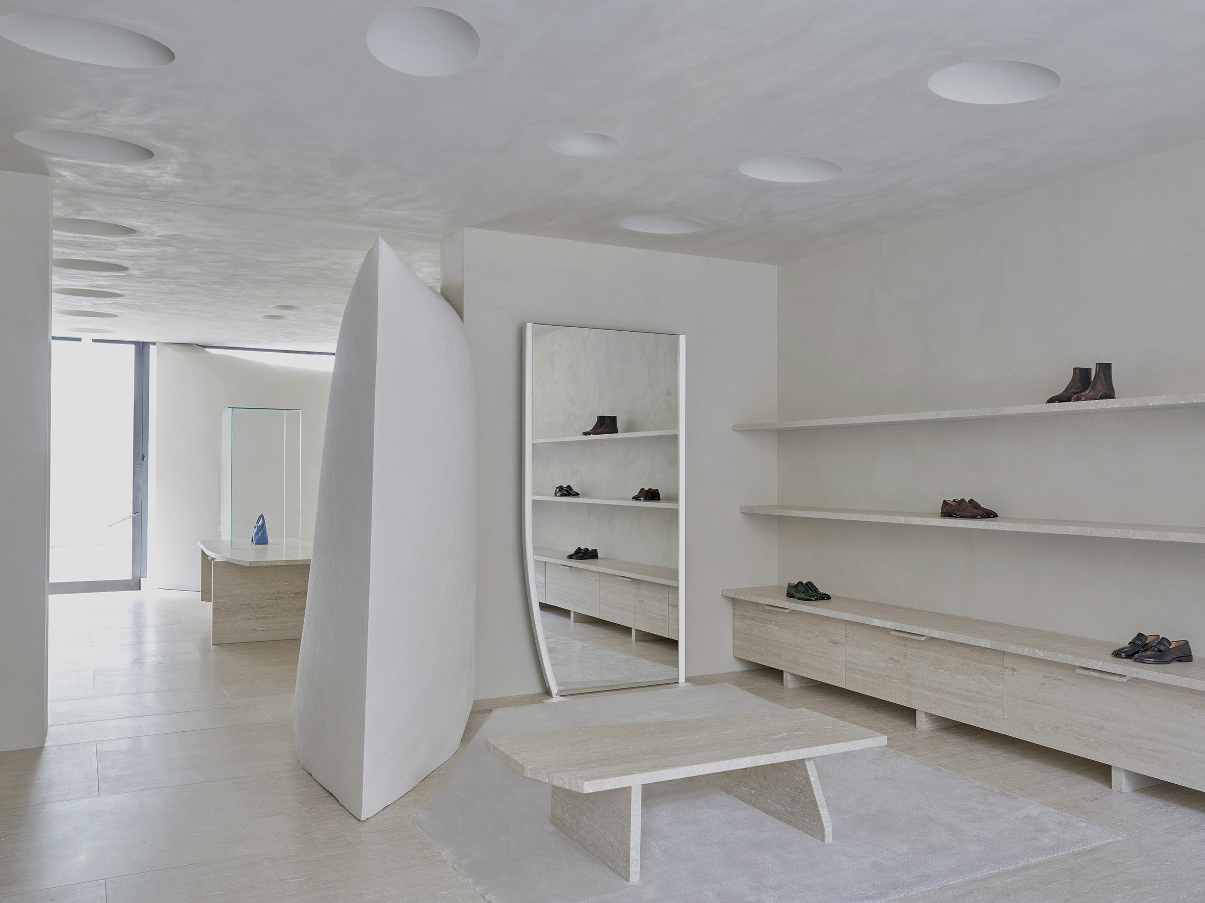 Travertine floors and furniture in Maison Margiela's London Bruton Street store by Studio Anne Holtrop