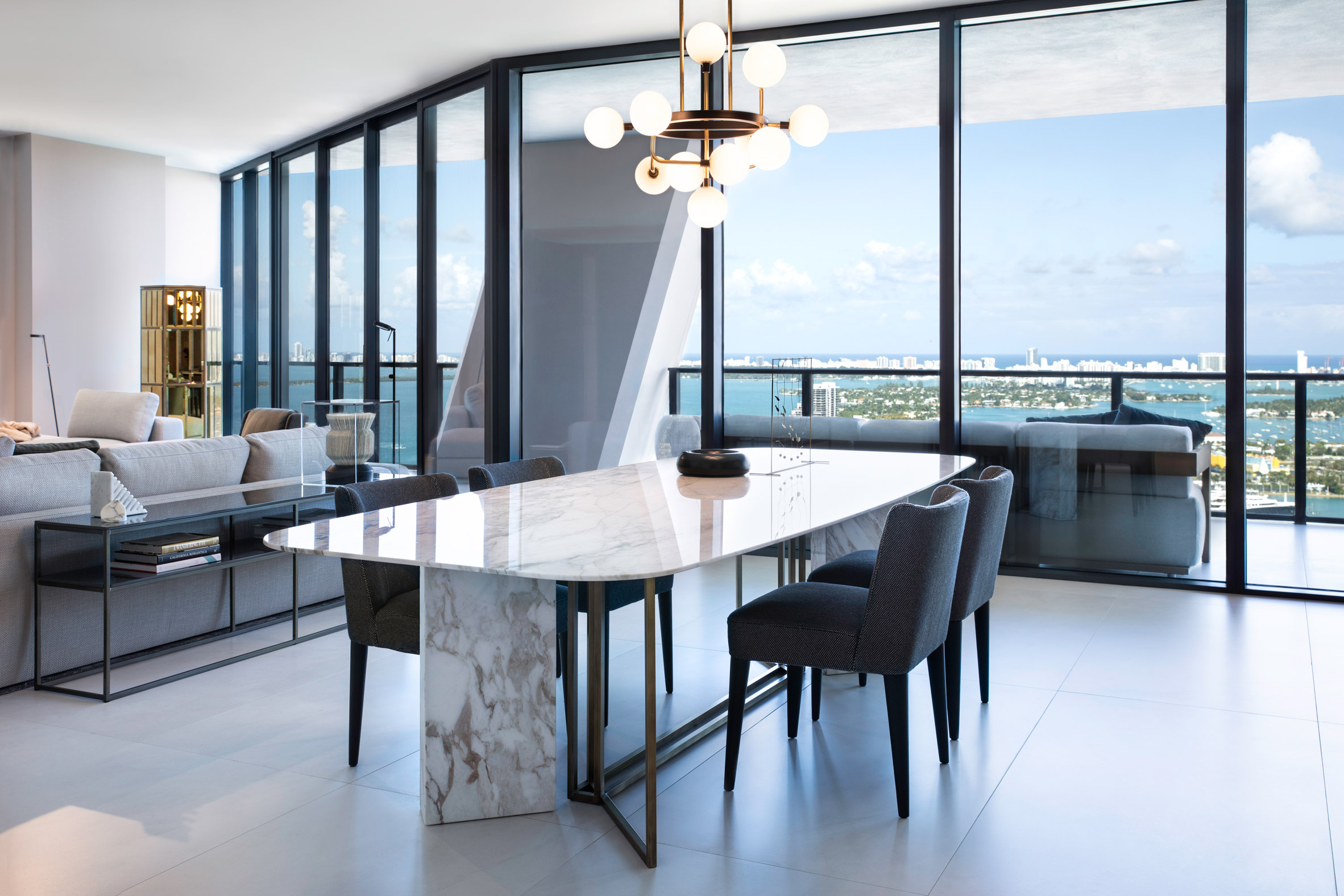Dining space in One Thousand Museum apartment by Meridiani