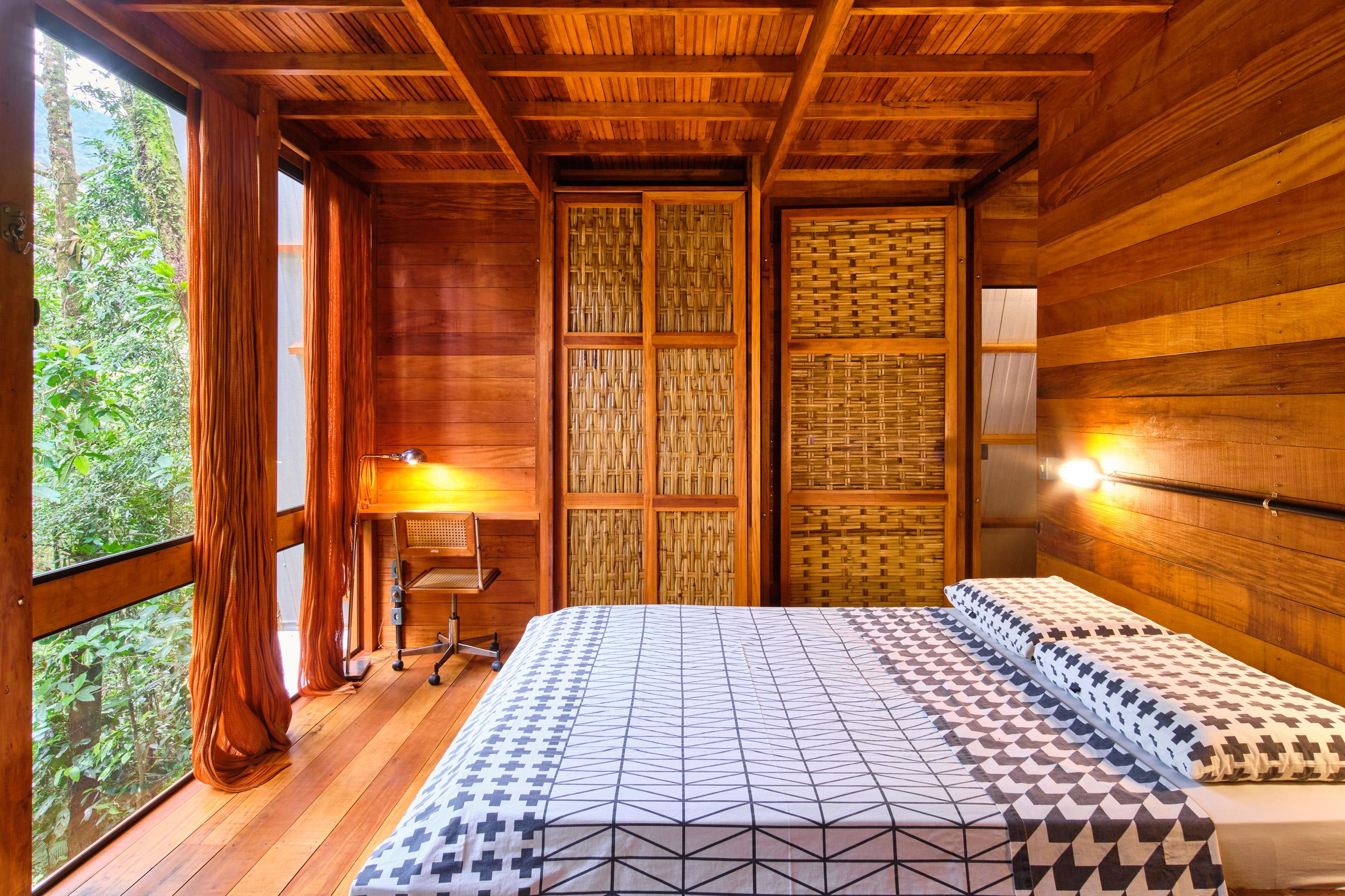 Bedroom of cabin on stilts in Brazil