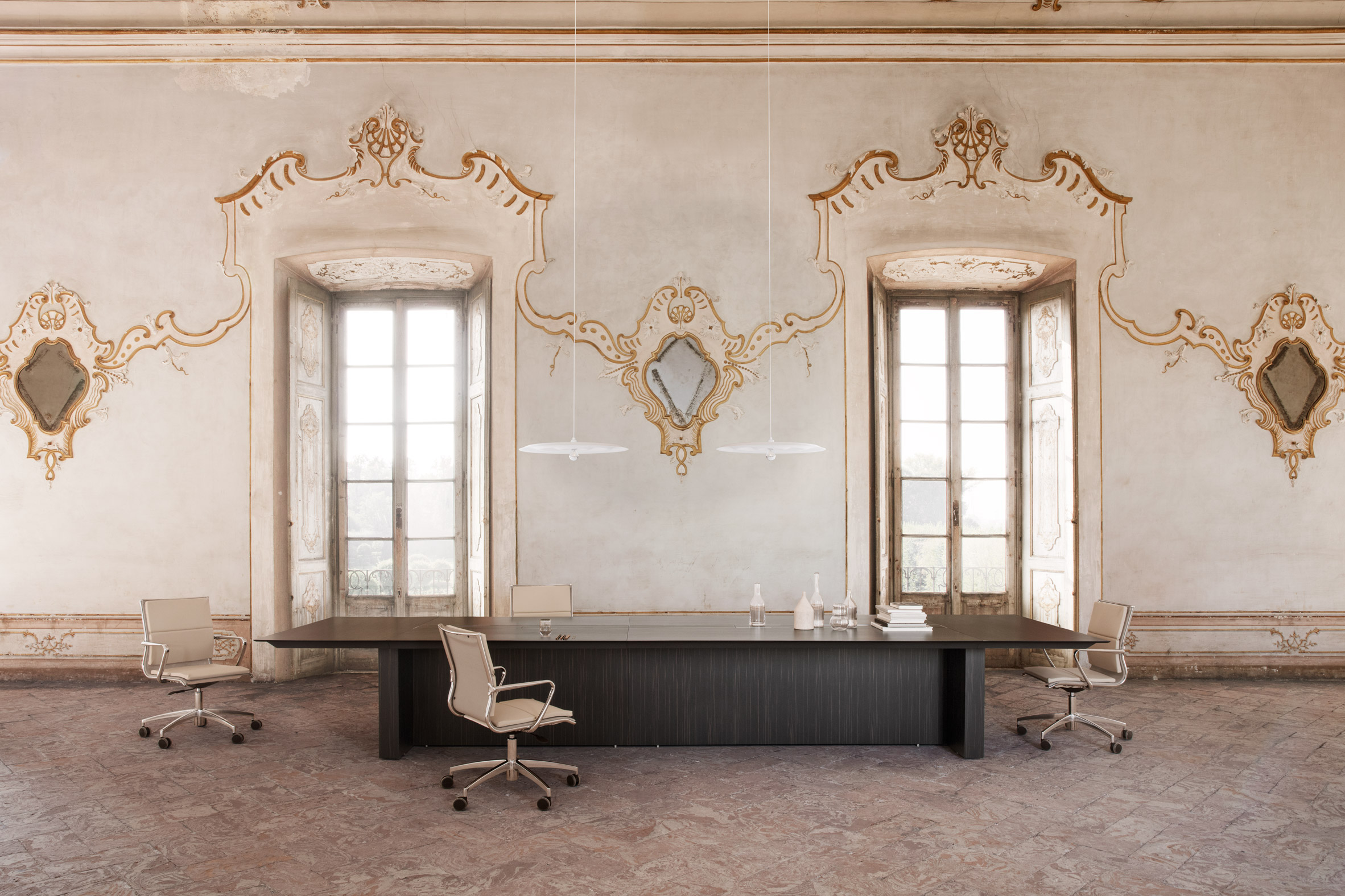 An office with a dark conference table