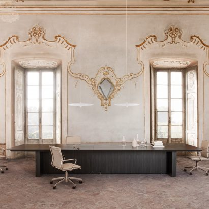 An office with a dark More conference table by Carlo Colombo