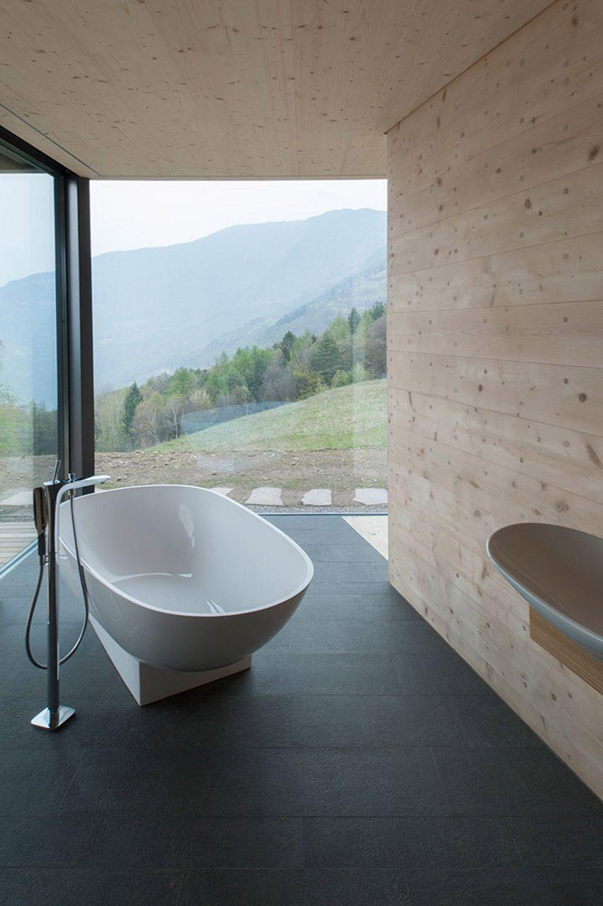 Bath in bathroom with glass walls