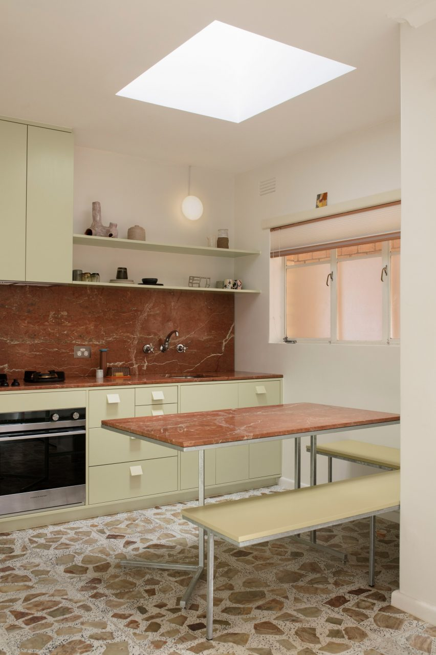 Pistachio green kitchen with bench seating and skylight in mid-century renovation by Murray Barker and Esther Stewart