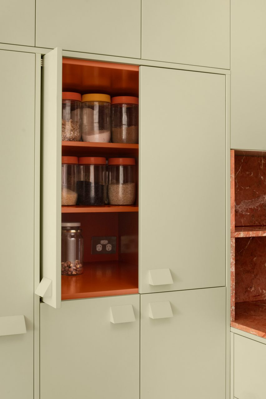 Pistachio green cabinets with red interior in mid-century renovation by Murray Barker and Esther Stewart