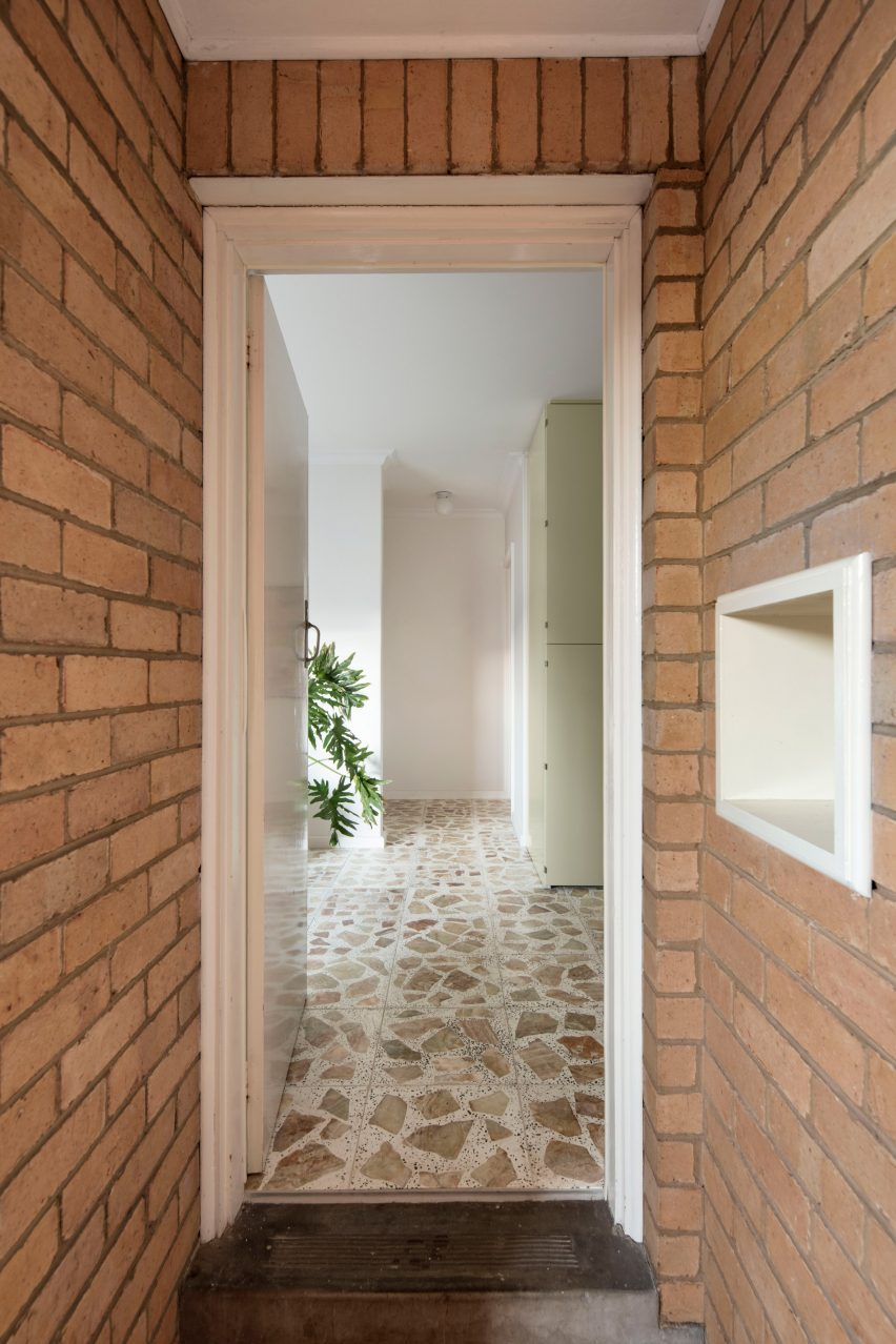 Brick walls and entrance of mid-century renovation by Murray Barker and Esther Stewart