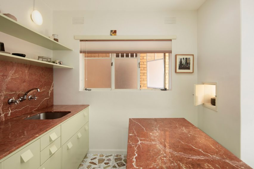 Red marble worktops and terrazzo tiles in mid-century renovation by Murray Barker and Esther Stewart
