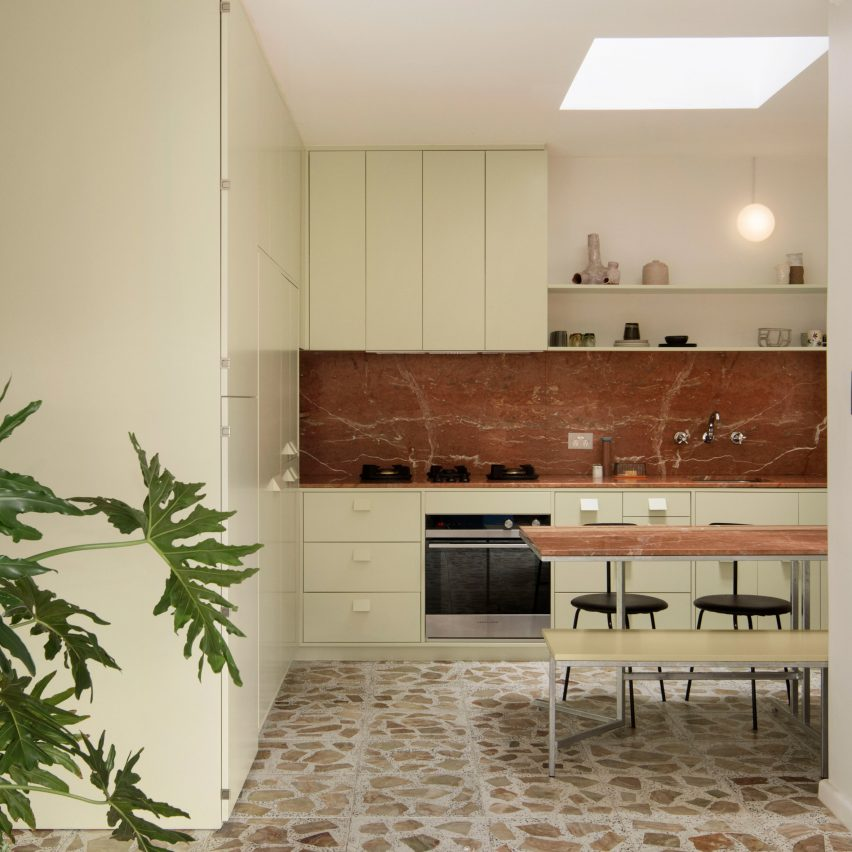 Pistachio green kitchen and terrazzo tiles in Brunswick apartment by Murray Barker and Esther Stewart