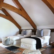 Plush sofabeds following the cottage's monochrome theme