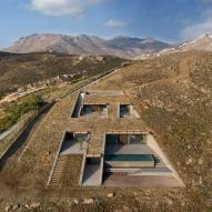 Mold Architects embeds cave-like house in hillside overlooking the Mediterranean Sea