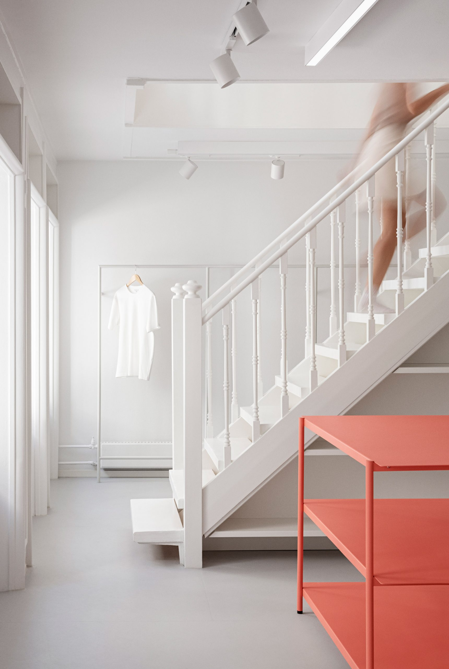 Traditional wooden staircase in the OCE Copenhagen store interior by Aspekt Office