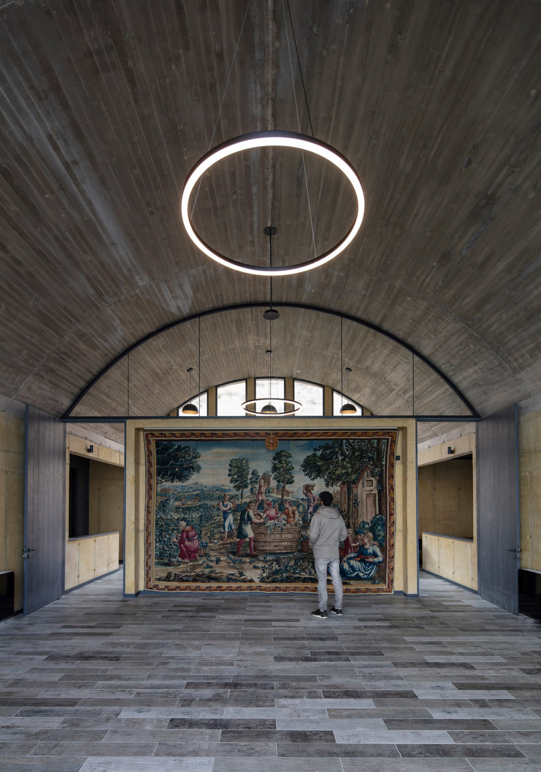 Tapestry in the middle of offices by MAPAA