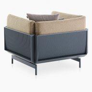 The metallic back of an armchair by Luca Nichetto for Gandiablasco