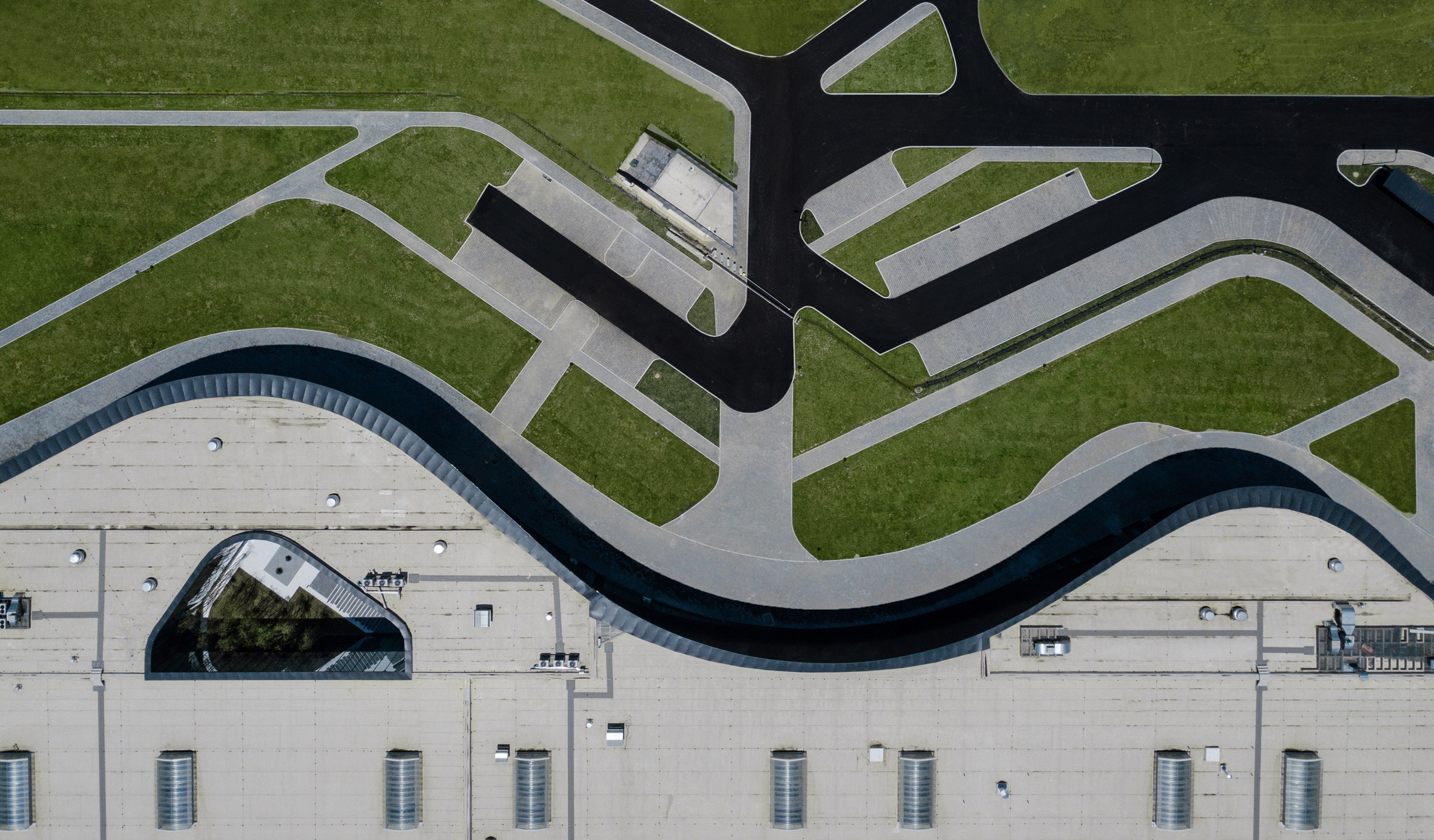 An aerial view of a curved building