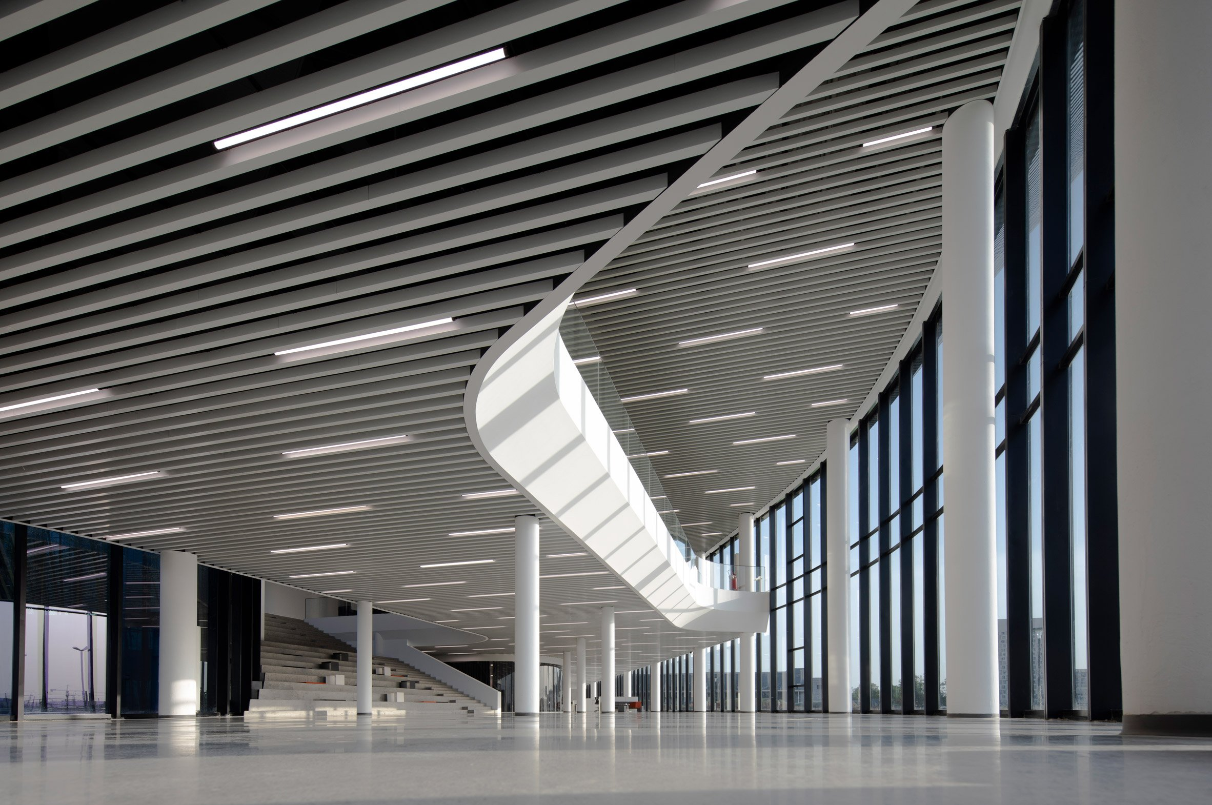 A white foyer in a factory by Snøhetta