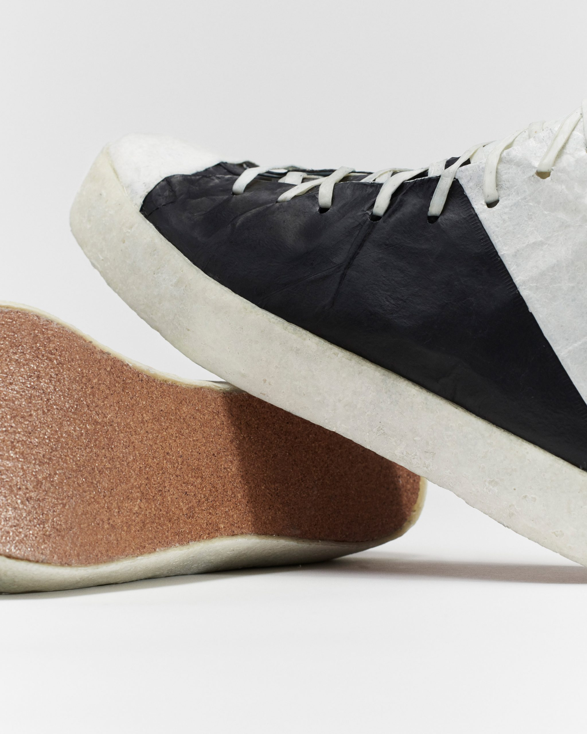 Close-up and cork sole of trainers designed by Public School and Theanne Schiros