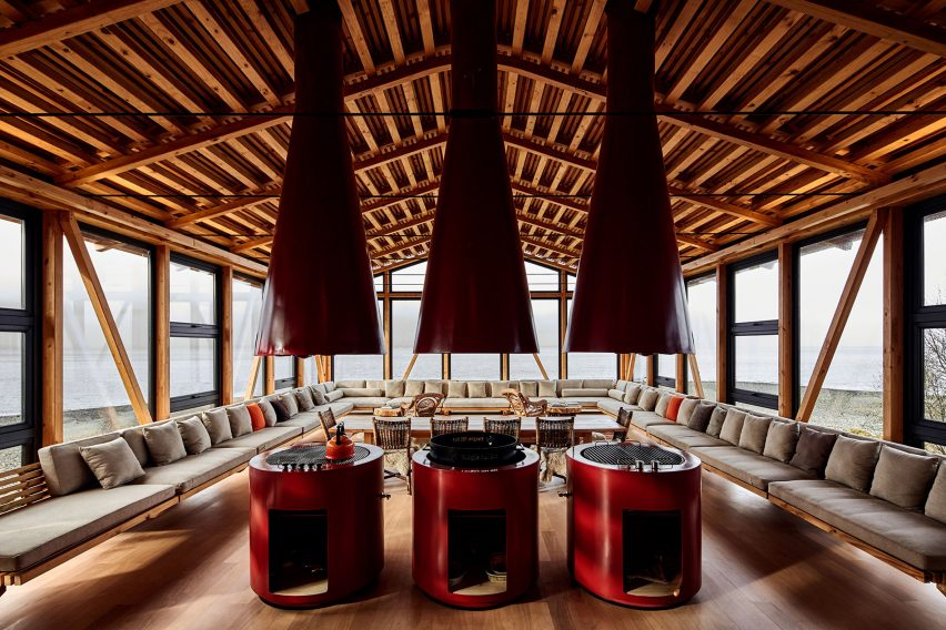 Red stoves in the pine-filled interior of Punta Chilen