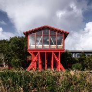 Guillermo Acuña raises seaside annexe on forest of red-painted pine stilts