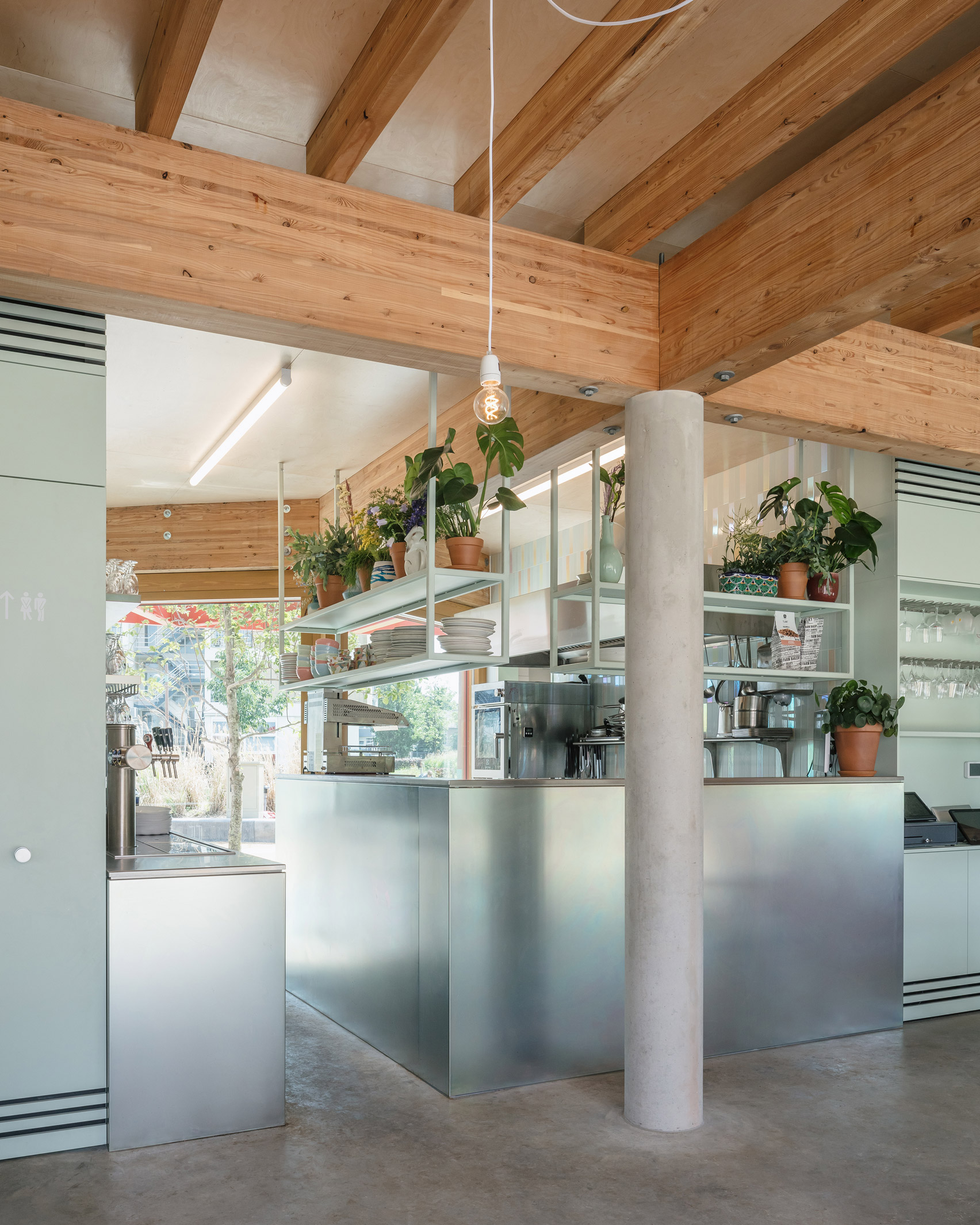 Steel and concrete restaurant interior with wood ceiling