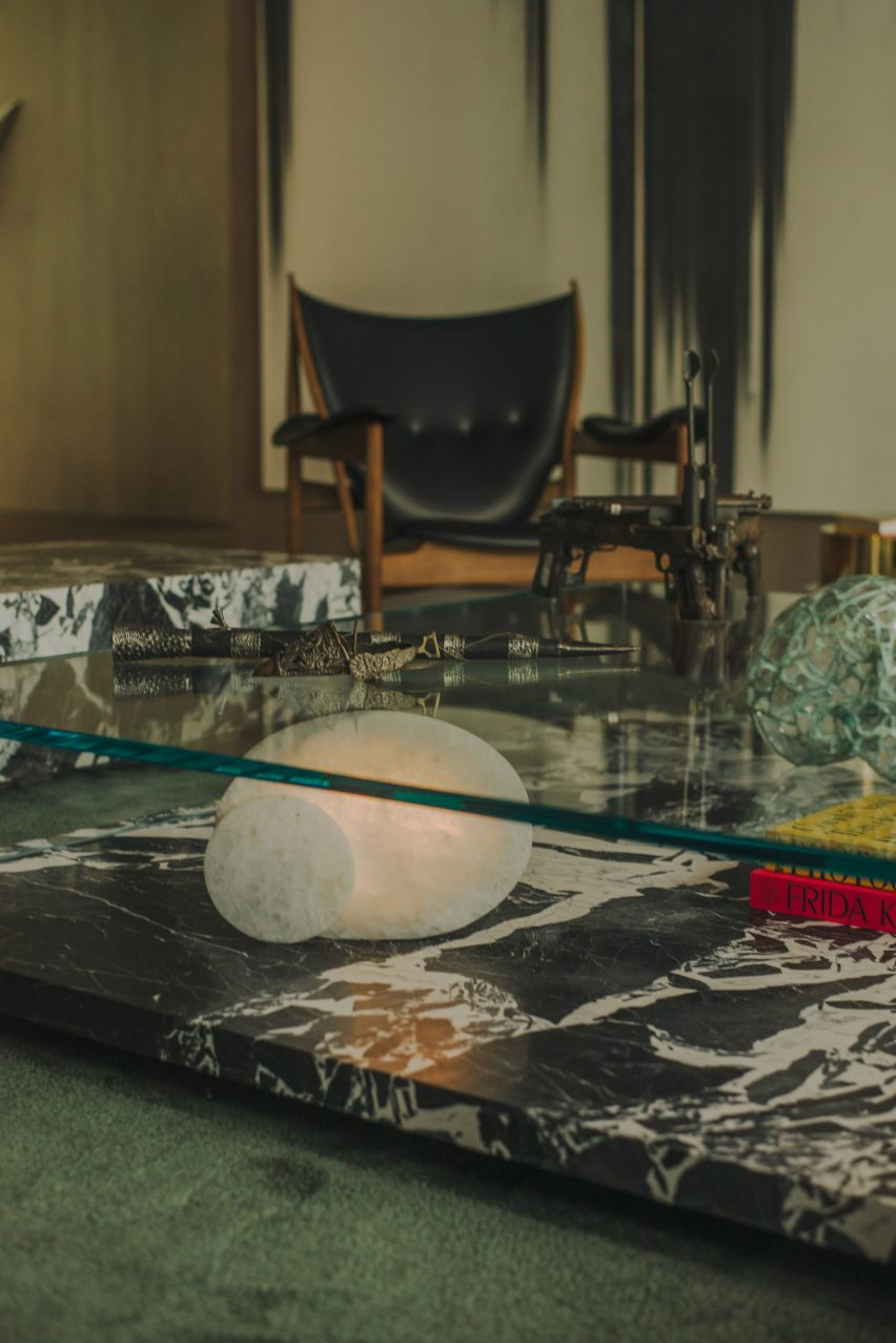 Marble and glass coffee table in AdH House living room by Simon Hamui