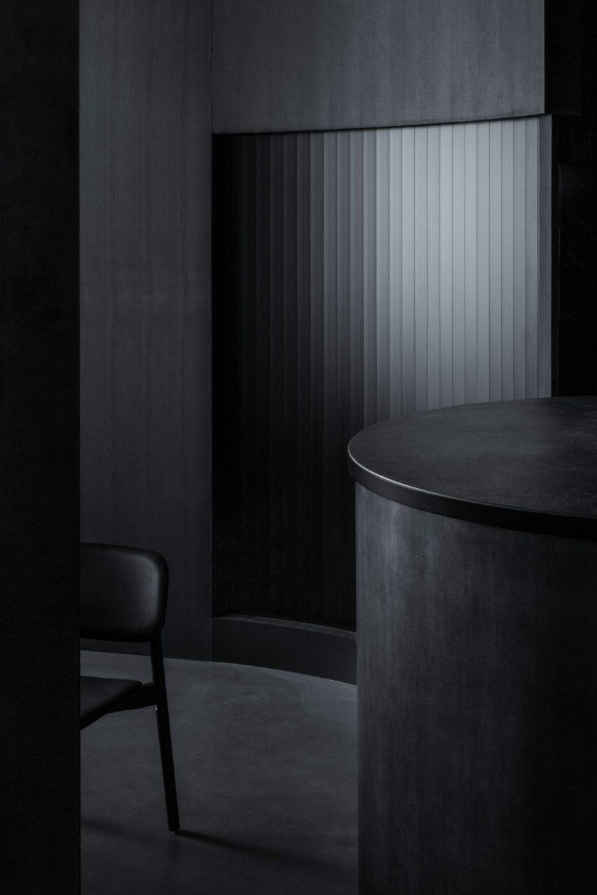All-black interior of Tokyo restaurant by Snøhetta