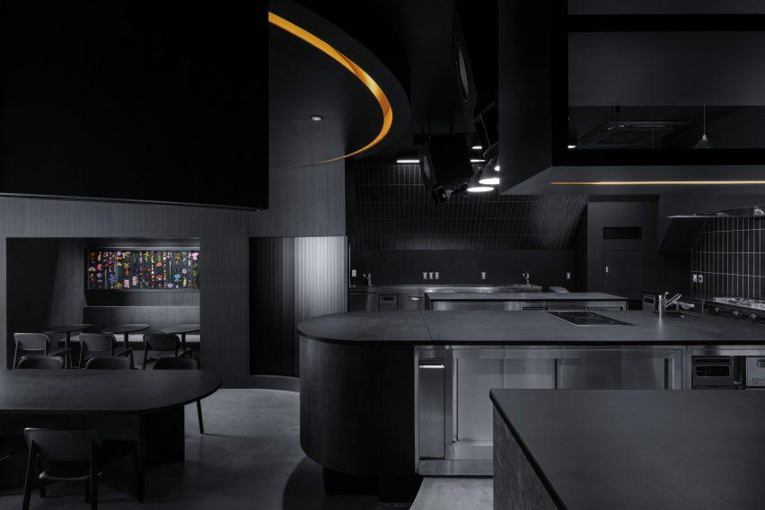 All-black open kitchen of Tokyo restaurant by Snøhetta