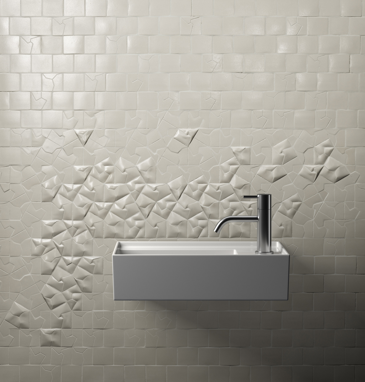 A white 3D-tiled bathroom wall