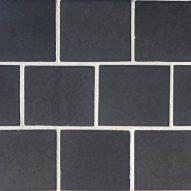 Dark grey tiles with white grouting