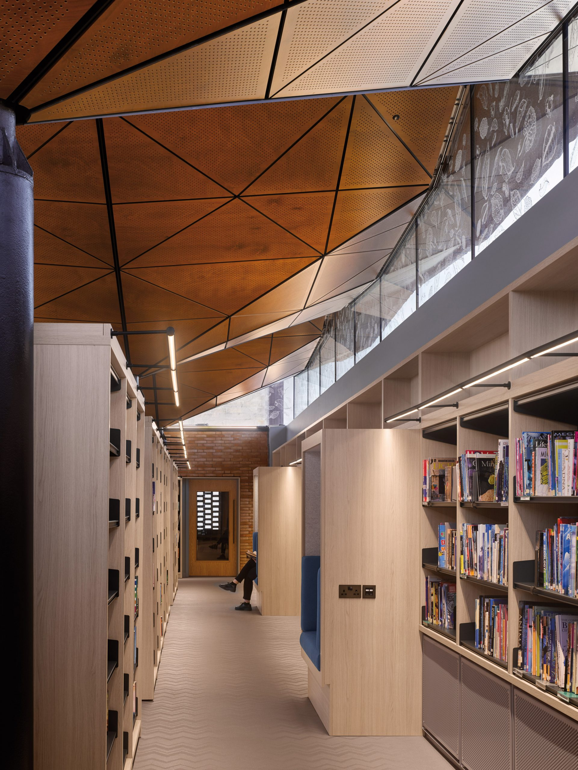 Formal library area has built in spaces for reading by Woods Bagot