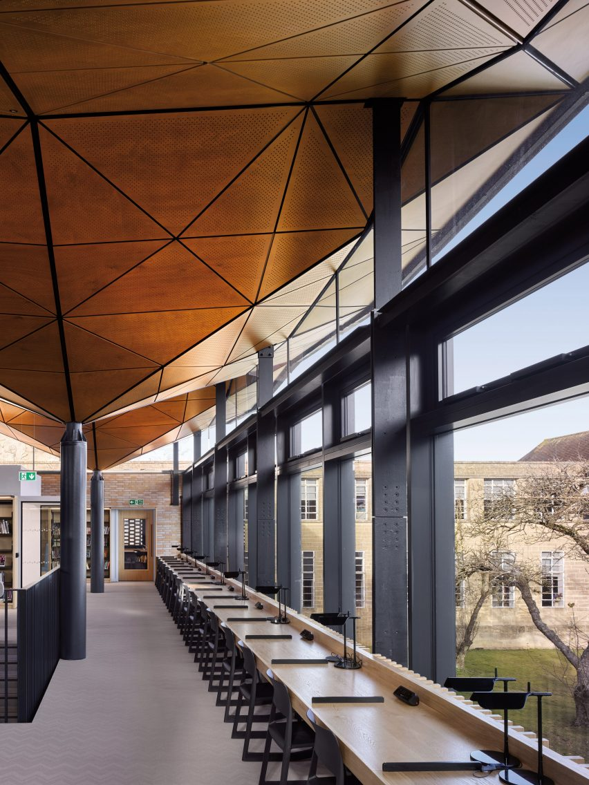 Geometric timber roof lines the interior of the design