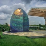 An egg-shaped temple outside an Indian house