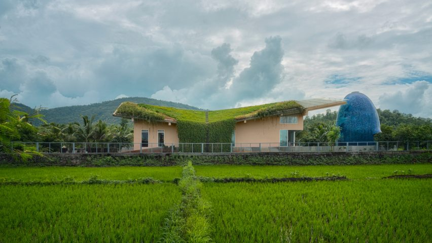 A rural Indian house with an egg-shaped temple