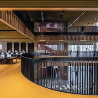 A bright yellow and wooden library interior