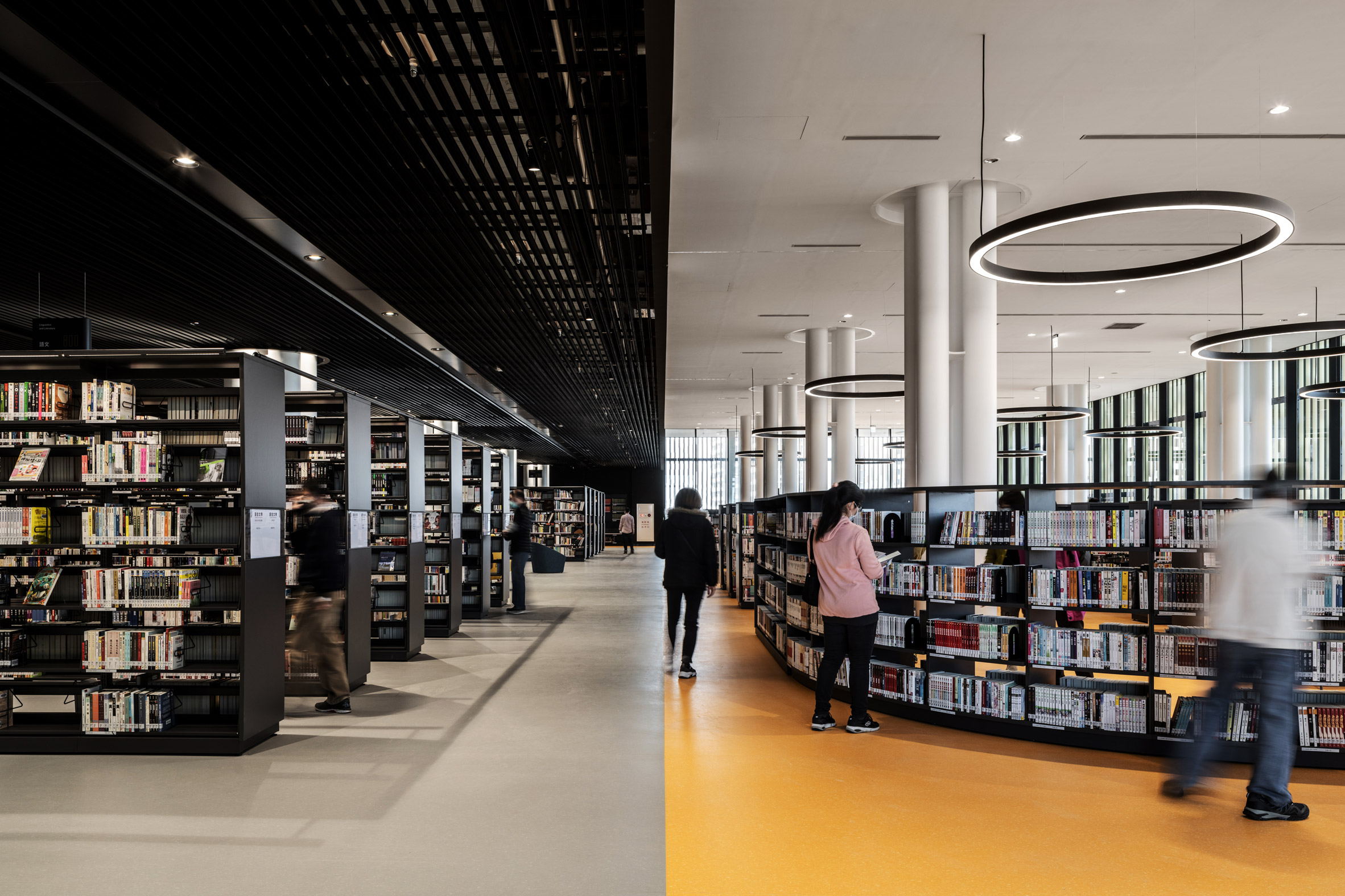 A library with a contrasting yellow and black interiors