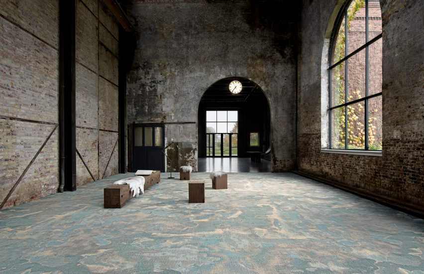 A marble-look carpet in a brick building