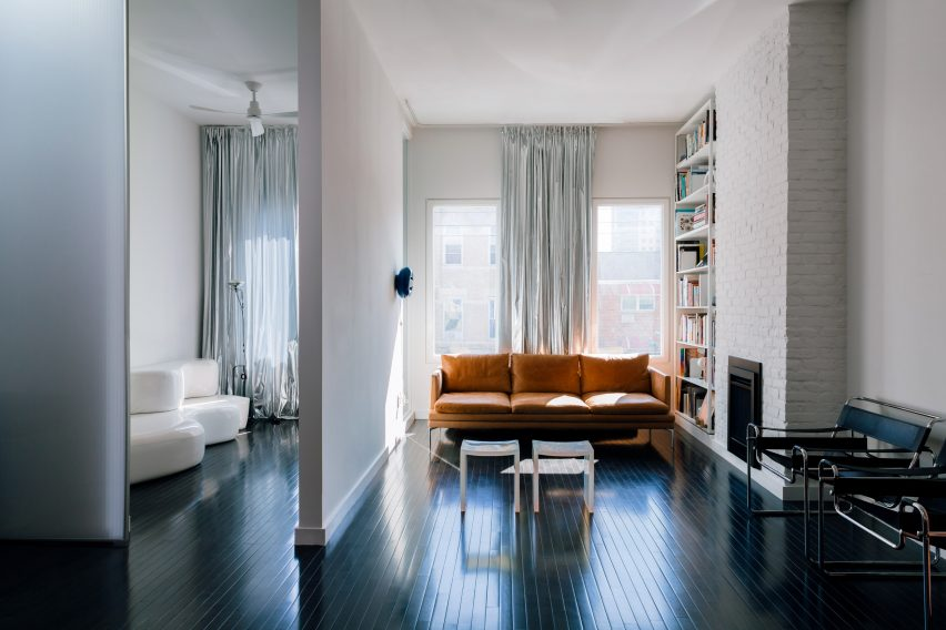 Renovated interiors including hardwood floors and exposed brick