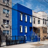 The Blue Building contrasts with the neutral properties on its street