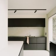 Black cabinetry in a Parisian townhouse by Clément Lesnoff-Rocard