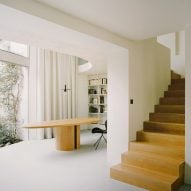 A statement wooden staircase in a Parisian townhouse by Clément Lesnoff-Rocard