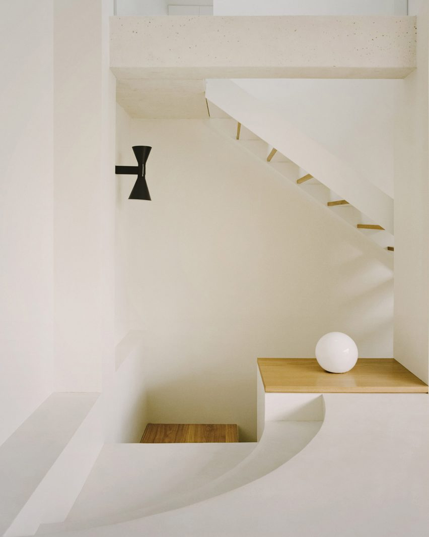 The white-walled stairwell of a Parisian townhouse by Clément Lesnoff-Rocard