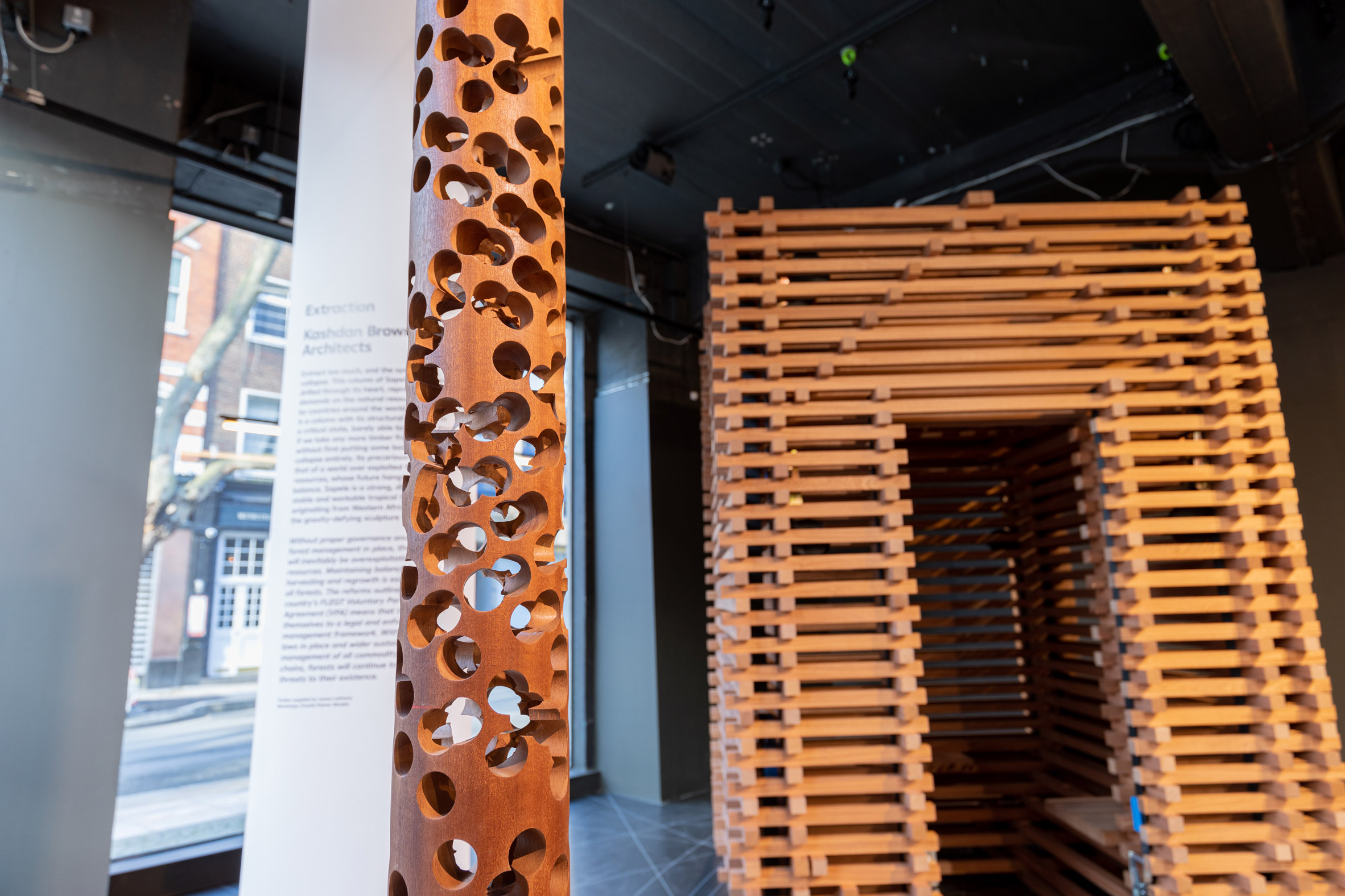 Extraction by Julia and Julian Kashdan-Brown and Sapele Sound Pavilion by Jeremy Yu and Tomos Owen from Conversations about Climate Change exhibition by the Timber Trade Federation