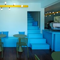 "Sky-blue cafe in Buffalo features ""Alice in Wonderland"" staircase"
