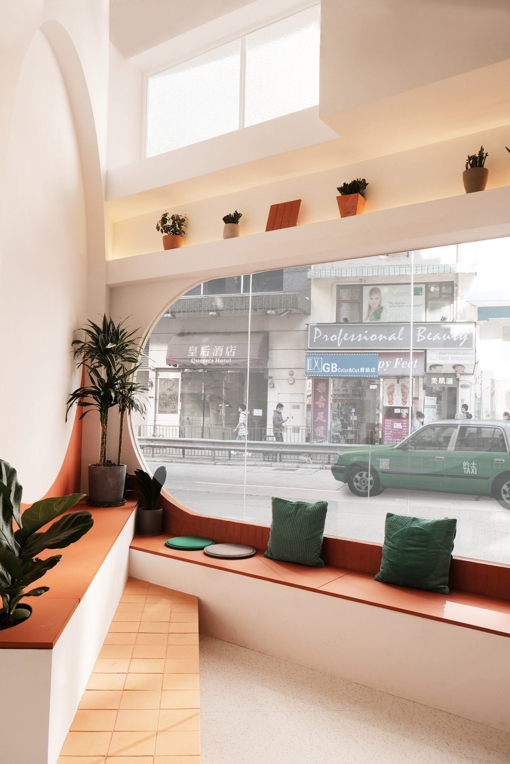 Rounded window and bench seating of Today is Long cafe by Studio Etain Ho and Absence from Island
