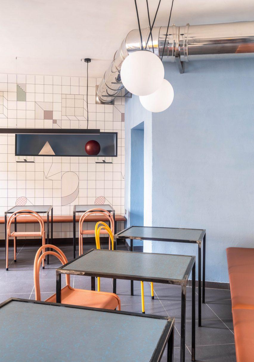 Dining room in Tre De Tutto by Studio Tamat