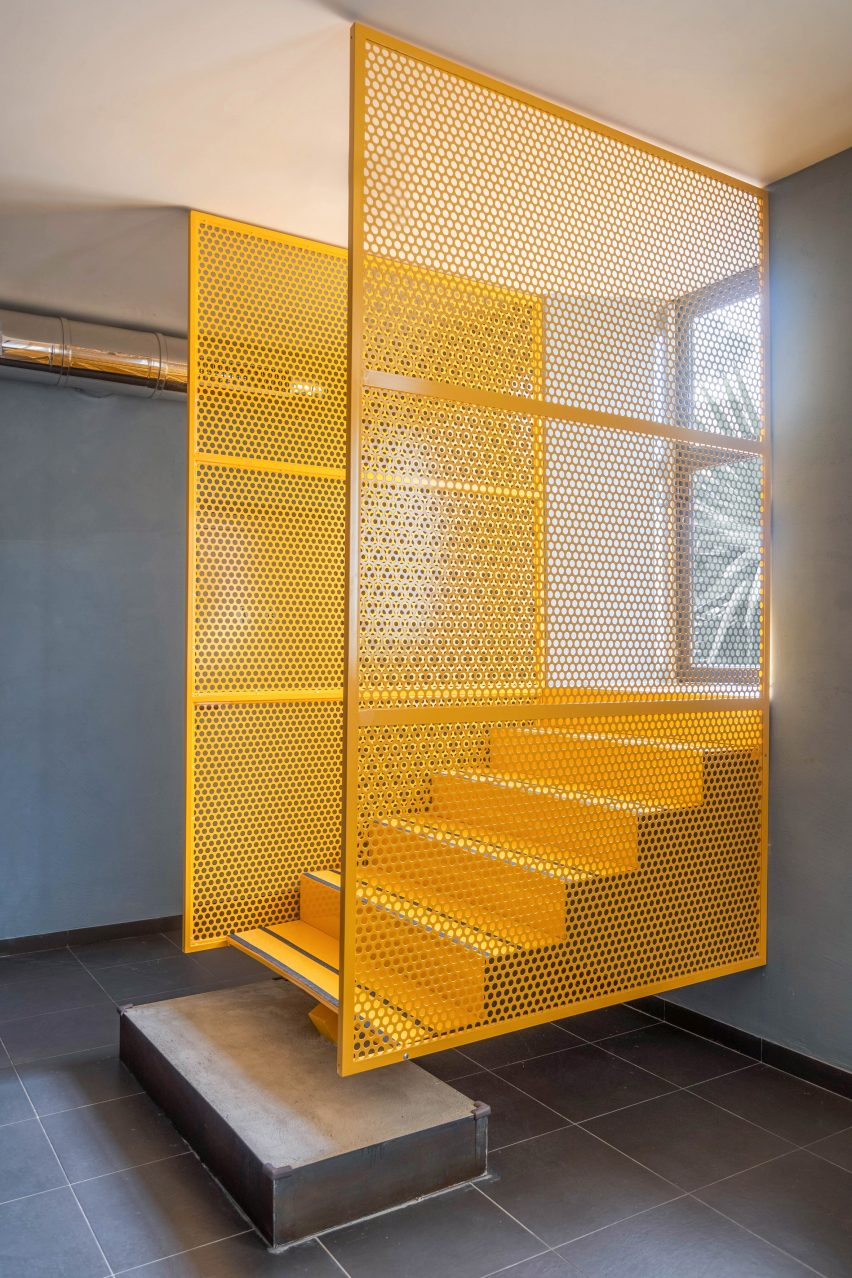 Yellow staircase in Tre De Tutto by Studio Tamat