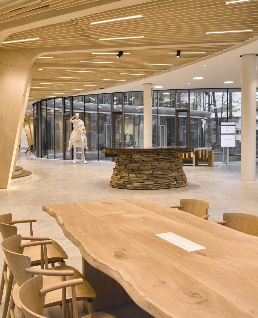 An office lobby with an exposed timber ceiling