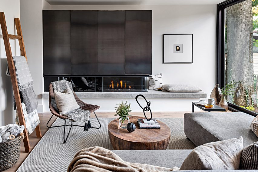 White living room with black fireplace