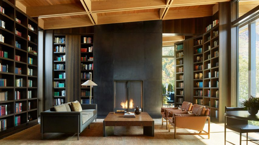 Tall built-in shelves and an open fire in living room