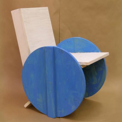 White chair with circular blue side panels from Grade Three Chairs project by Bruce Edelstein at Trinity School